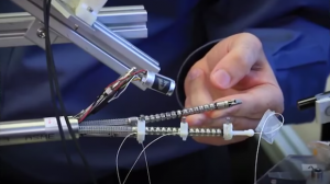 Touch-Sensing Robot Avoids Obstacles While Surgeons Operate