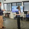 Can Stepping Inside a Virtual Cancer Cell Improve Collaboration?